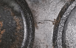 Zoomed in Image of a Crack between exhaust bores on MAN cylinder head for Cast Iron Repairs