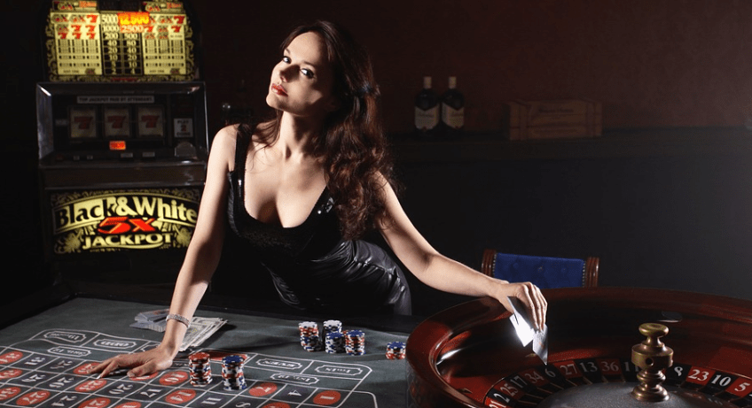woman at casino with cards
