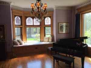 The Grand Piano in the Music Room of Castle La Crosse Bed and Breakfast in La Crosse, WI