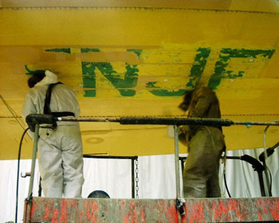 Last traces of former registration C-FNJF are removed for repaint, May 2005