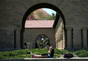 Image of a woman works on a laptop on the Stanford University campus on May 22, 2014 in Stanford, Calif. Justin Sullivan / Getty Images