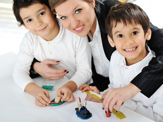 Mother working with sons on homework project logo