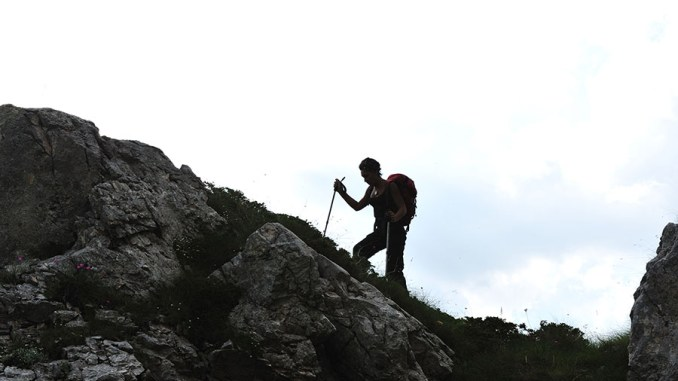 Silhouette of a woman during and adventage climbing and mountain image
