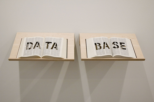 """DATABASE at Postmasters, March 2009  DATA BASE is an Oxford English Dictionary with the word """"DATA BASE"""" cut into it with the laser cutter."""