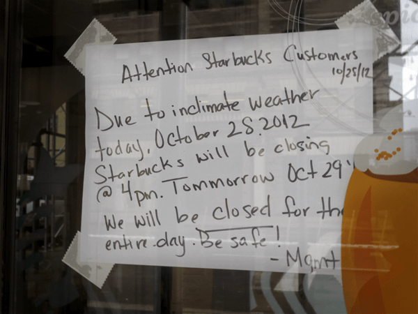 sign in the window at Starbucks