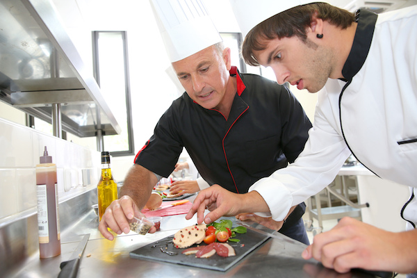 Chef helping student in education
