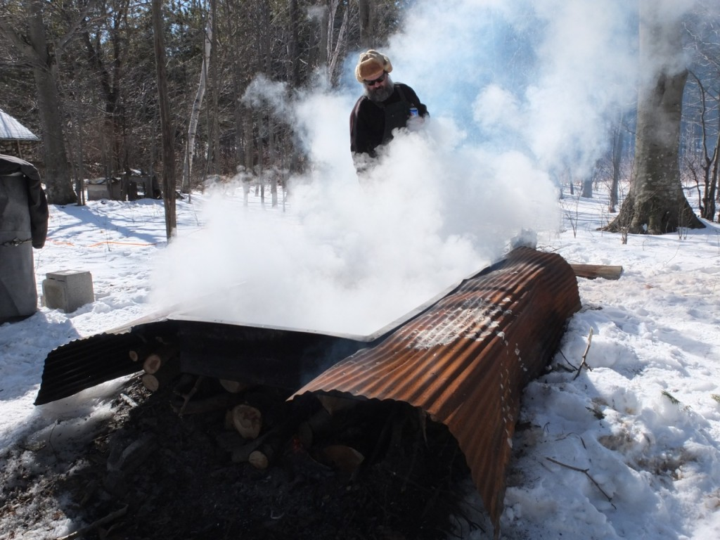 Maple sugaring time - Russell Madson works the evaporator