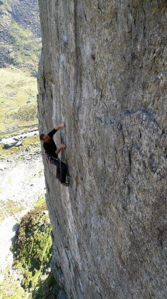 An unknown climber on the beautiful and well protected Left Wall, about 5.11a. Dinas Cromlech, Llanberis Pass.
