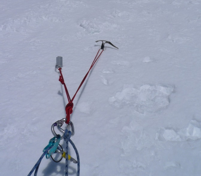 Snow anchor in hard snow in Tuckerman Ravine.