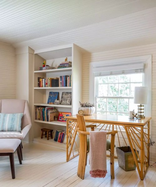 a wonderful home office with built-in cabinets and a cozy reading nook - cat french design