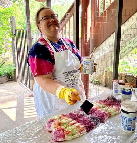 Kellie applying dye to the yarn.