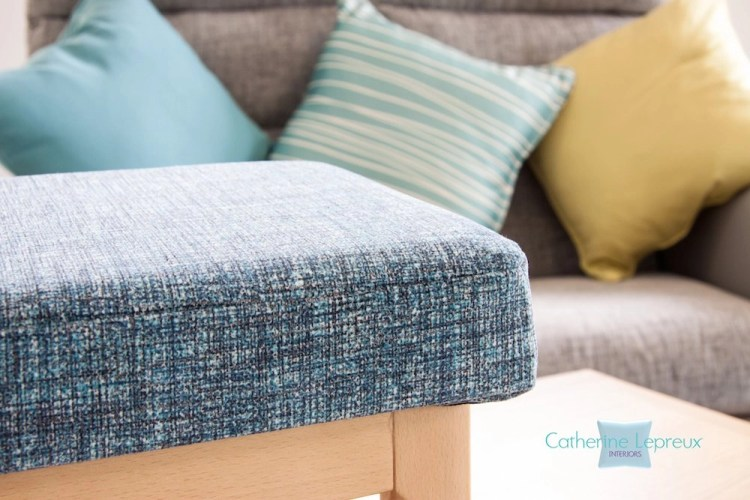 Footstool upholstered in teal fabric from Panaz