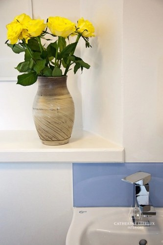 Pale blue glass splashback in an Edinburgh cloakroom
