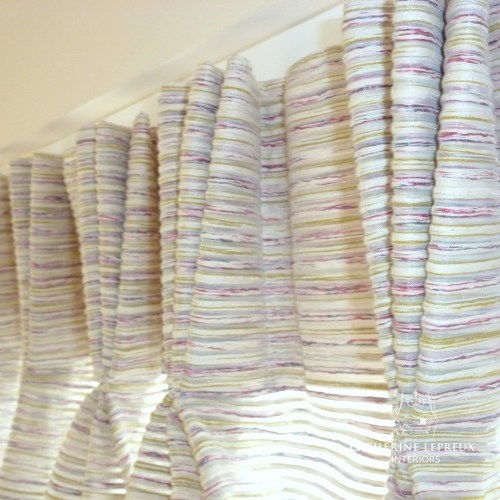 Semi-sheer voile curtains with a triple pleat heading. Fabric by Harlequin