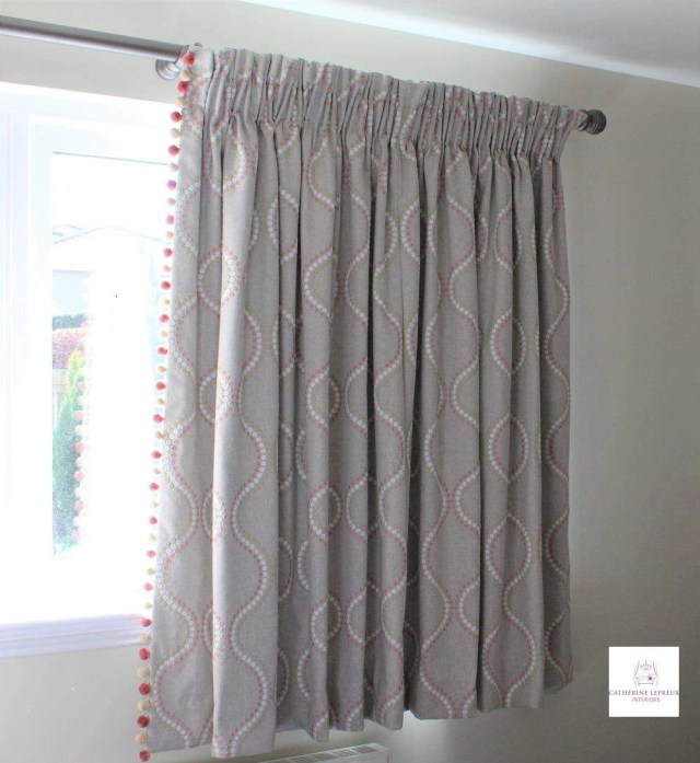 edinburgh curtain maker-embroidered linen curtains with gathered frill heading pink pom pom trim in a Fife girl's bedroom