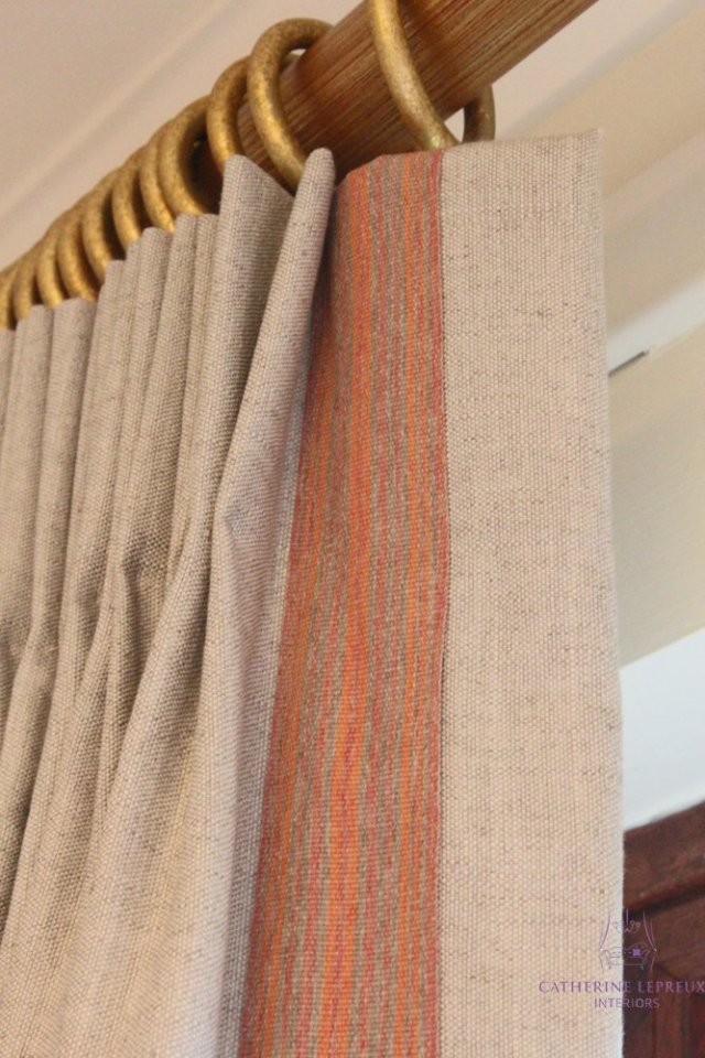 Neutral linen pinch pleat curtain red contrast braid trim Samuel and Sons red gilt curtain pole