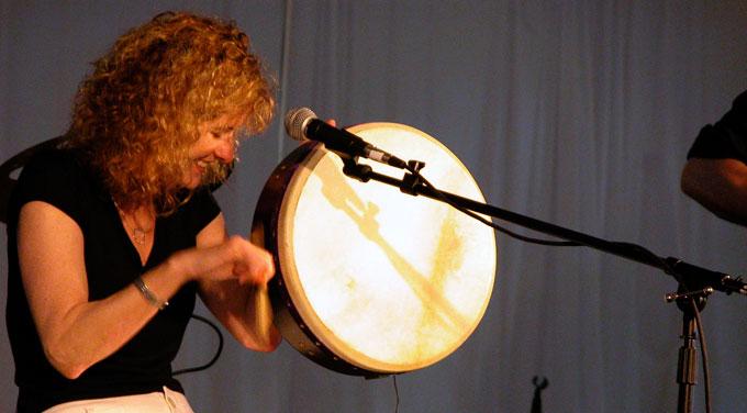 Cathie Ryan playing bodhrán