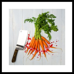 01-029_1_frameSmall Bunch of Carrots with leaves on a board being cut with knife_2016_6193-Tw