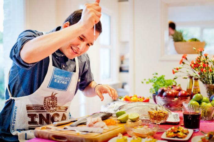 Man in kitchen.