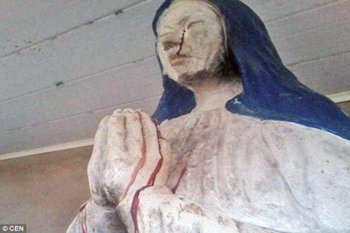 A picture of the weeping statue of the Virgin Mary. Parishioners say she is weeping blood.