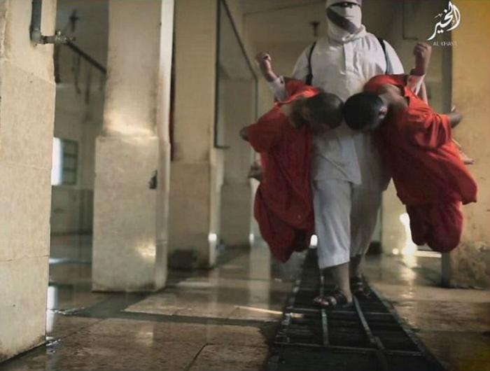 One Jihad carried a man in each arm to a drain where they had their throats slashed.