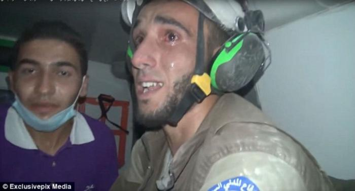 Rescuer Abu Kifah burst into tears when he realised the baby was alive.