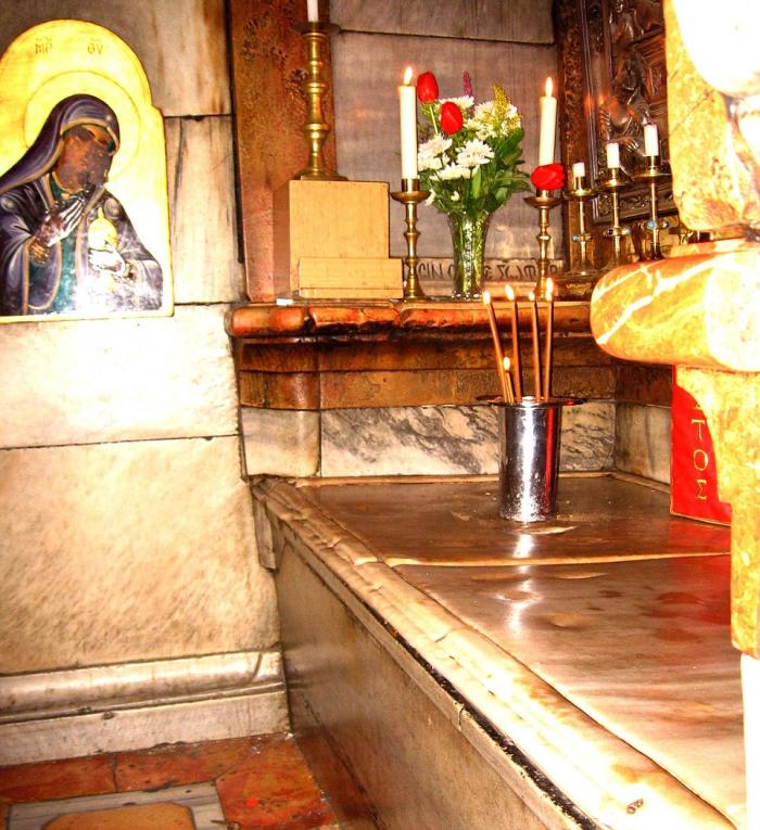 This marble slab is all that has protected the limestone burial slab of Christ for five centuries.