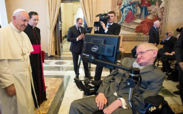 Pope Francis greets Stephen Hawking.