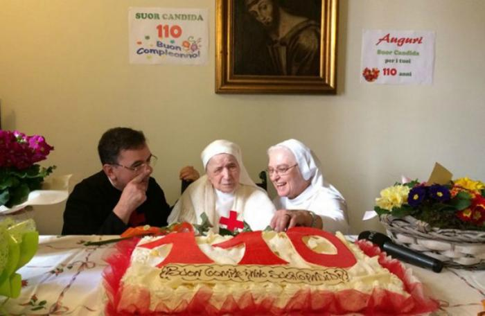 Sister Candida Bellotti (center) at the celebration for her 110th birthday in Italy.
