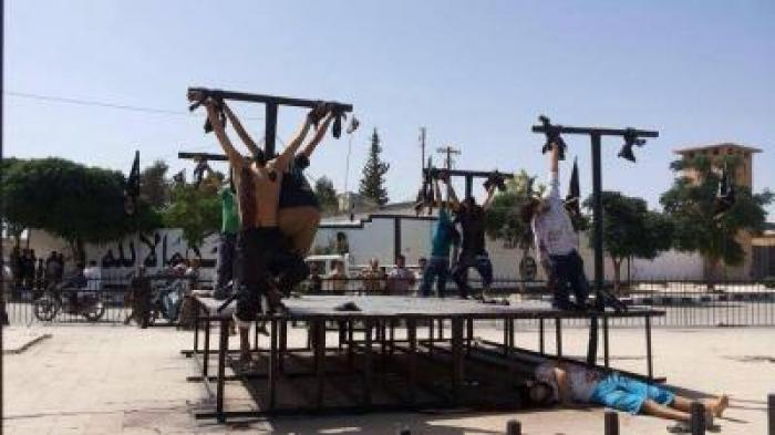 Convert or die. ISIS militants are crucifying victims because to them crucifixion is especially humi