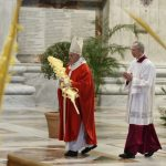 Pope Francis celebrates Palm Sunday in nearly empty St Peter's Basilica