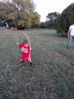 Peter pretending to be Robin Hood.