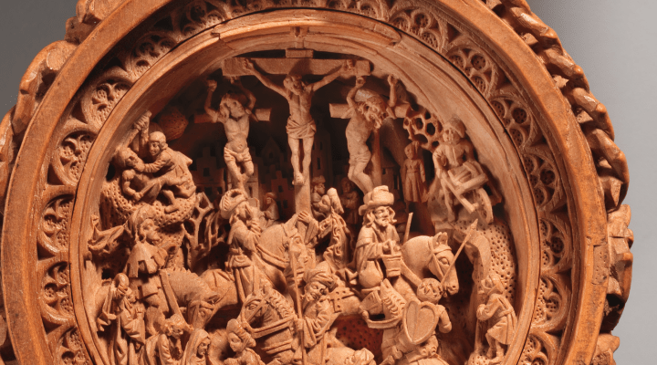 The Crucifixion is carved into the lower half of the interior of the bead.