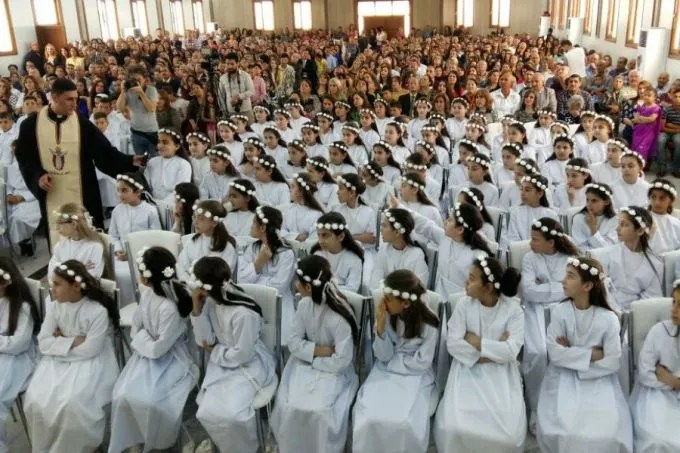 Refugee children in Erbil receive their First Communion May 27, 2016. Photo courtesy of Deacon Roni Momica.