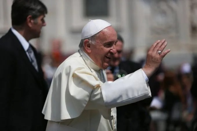 Pope Francis waves to the crowd gathered in St. Peter's Square for the Wednesday General Audience on May 27, 2015. Credit: Daniel Ibanez/Catholic News Agency