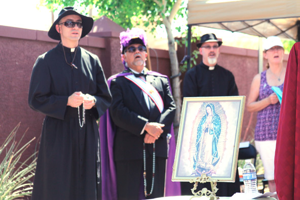Local priests and the Knights of Columbus joined Bishop Thomas J. Olmsted in praying for the unborn outside a Planned Parenthood on Good Friday.