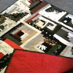 "62"" x 62"" all cotton pieced red, black and white quilt, machine quilted with red cotton backing $250"
