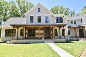 custom new home in maryland with wooden accents entry