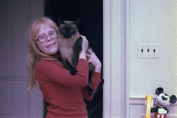 First daughter Amy Carter with her Siamese cat Misty Malarky Ying Yang.