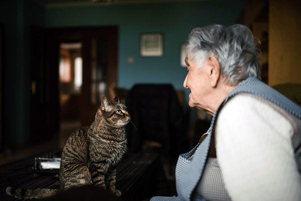 An elderly woman with her cat.