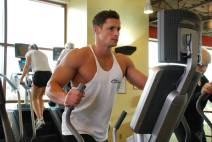 man using elliptical trainer