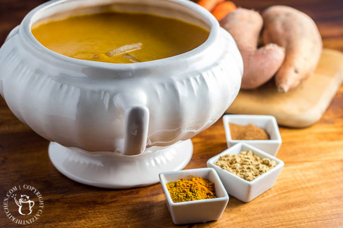 This easy recipe for slow cooker curried sweet potato & carrot soup is spice-forward! Bland soup be gone, this creamy bowl of spiced goodness will delight your tastebuds!