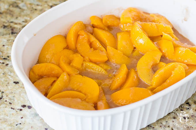 Old Fashioned Peach Cobbler is literally a recipe for comfort! This easy dessert features hints of cinnamon and nutmeg alongside sweet, juicy peaches - yum!