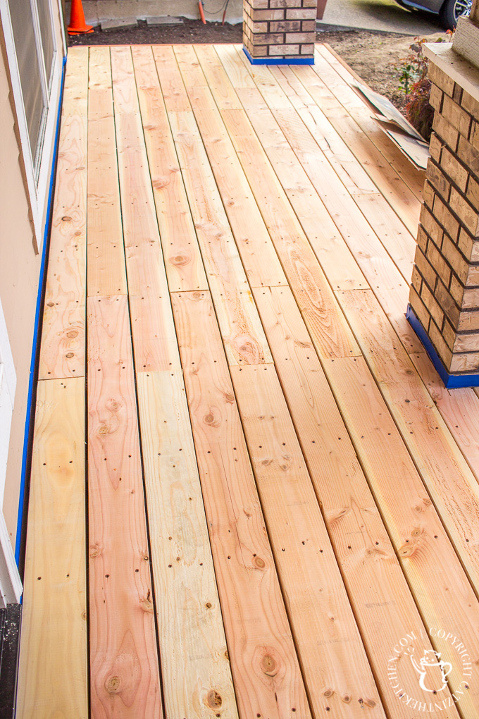 If you've ever thought about turning your cement porch into a wood deck, it's surprisingly easy! Here are some thoughts, tips, & photos from our experience!