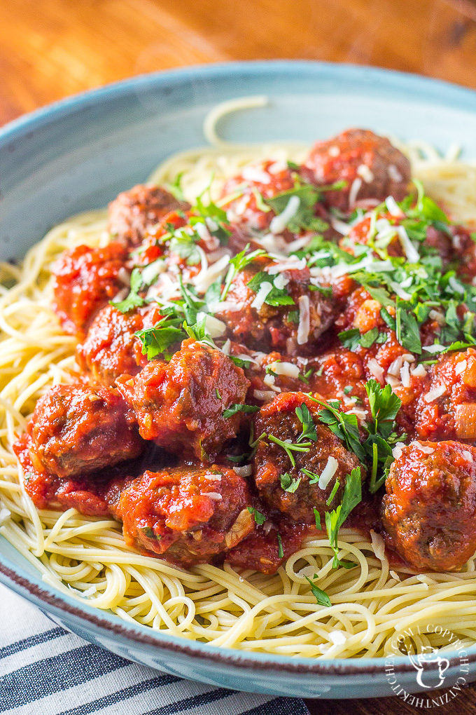 Finding spaghetti and meatballs a bit bland? So were we! This recipe for the classic pasta dish is easy, cheap, and bursting with flavor!