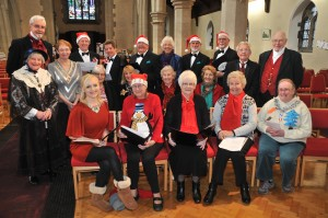 Top UK Gospel singer Philippa Hanna, front left, with members of Malton Male Voice Choir and the town's Harmonia Choir at St Peters Church on Saturday for the recording and filming of a song inspired by Charles Dickens' classic tale A Christmas Carol. Picture David Harrison.