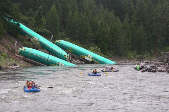 Three Boeing 737 fuselages lie on an embankment on the Clark Fork River after a BNSF Railway Co train derailed near Rivulet