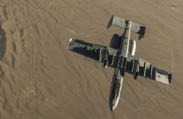 U.S. Air Force A-10 Thunderbolt II with the 303rd Expeditionary Fighter Squadron, Bagram Airfield, Afghanistan, peels away from a KC-135 Stratotanker over Eastern Afghanistan, July 10, 2014.