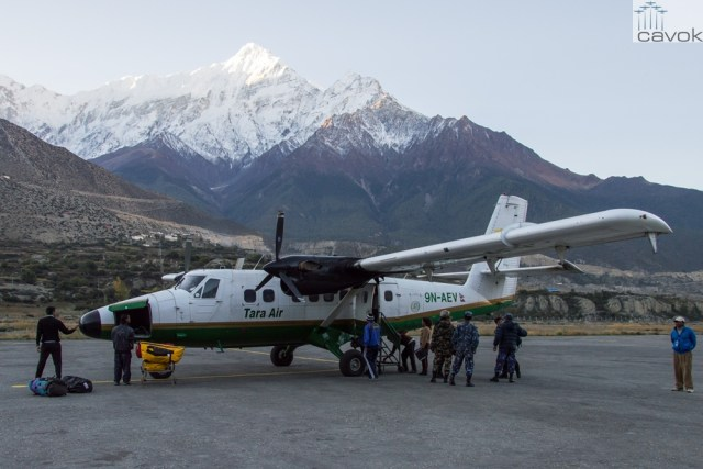 Tara Air DHC-6 Twin Otter 9N-AEV in Jomsom airport with Nilgiri on the background