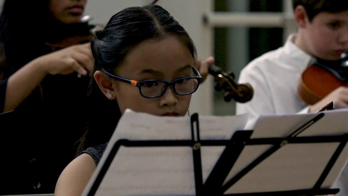 Cayman Youth Orchestra scores a home run!